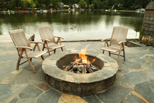Attractive slate patio and matching firepit creates gathering point to enjoy lake views. Client: Bradley - Lake Oswego, OR    Landscape Designer - Big Sky
