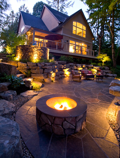 A great outdoor firepit design creates new places for people to congregate and tell tall tales into the night.